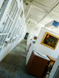 14 Working Artists Studios sit behind window walls that allow visitors to look through and see artists at work.