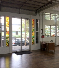Our 10 foot high entrance doors are framed by stunning pieces of stained glass.