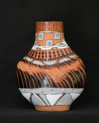earthenware with slips and glazes - multi-fired piece