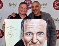 Meeting Robin Williams with artwork for signing